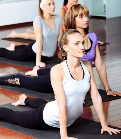 A group of women doing yoga