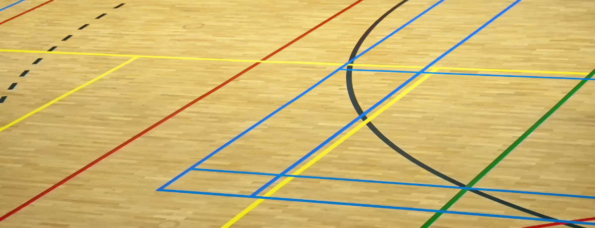 Gym floor with markings for various courts